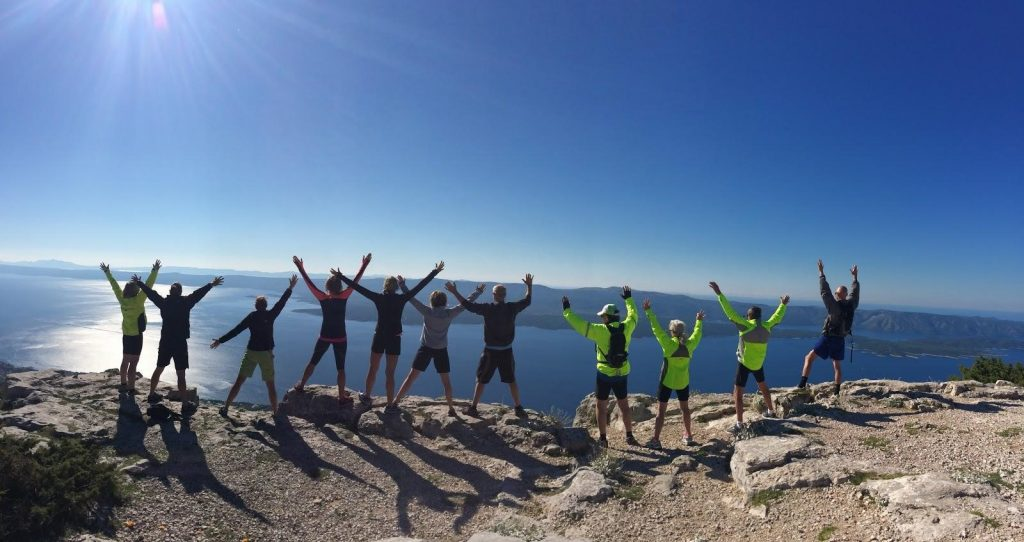 A tour group lead by USTOA member VBT Bicycling and Walking Vacations takes in the view from high above Brac, Croatia.