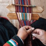 A woman at the Chinchero Weaving Collective creating a meticulous pattern