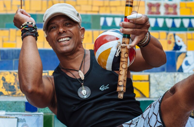 A local gentleman plays a berimbau on the Escadaria Selarón