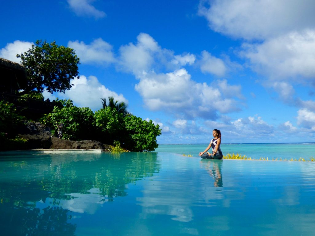 (credit Pacific Resort Hotel Group, Pacific Resort Aitutaki, Cook Islands)Yoga on the edge