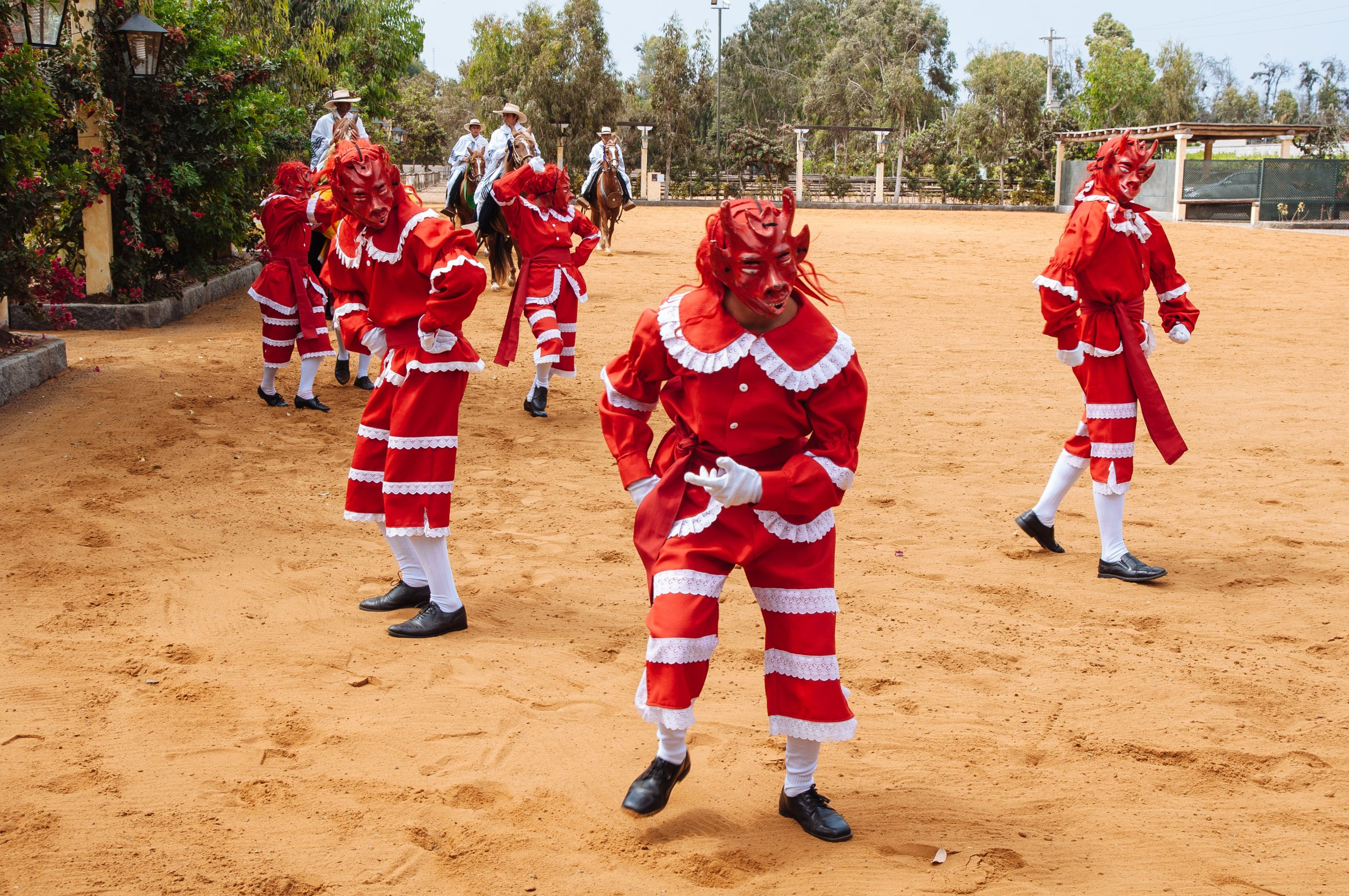 Performers doing the Dance of the Devils' at Hacienda Mamacona