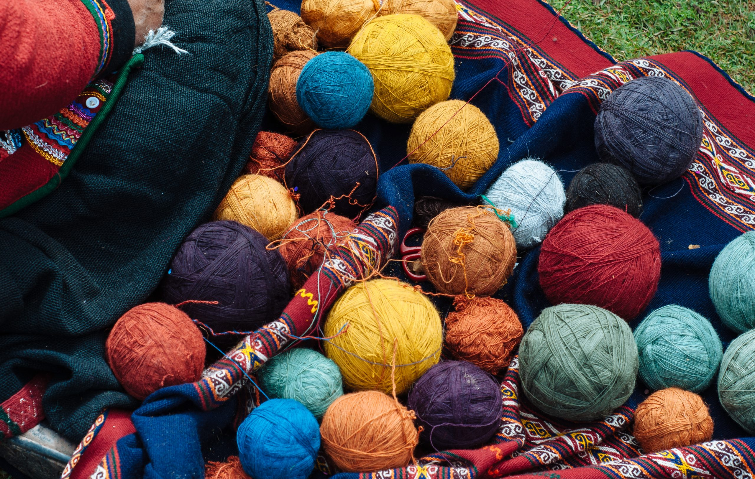 An array of colorful yarn used to create beautiful textiles