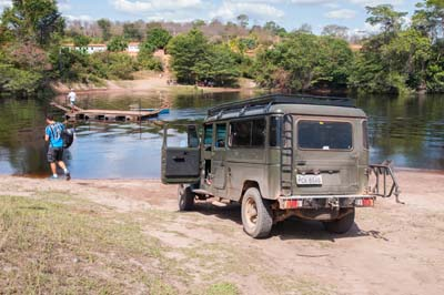 Our vehicle waits to be floated across a pond within Chapada Diamantina