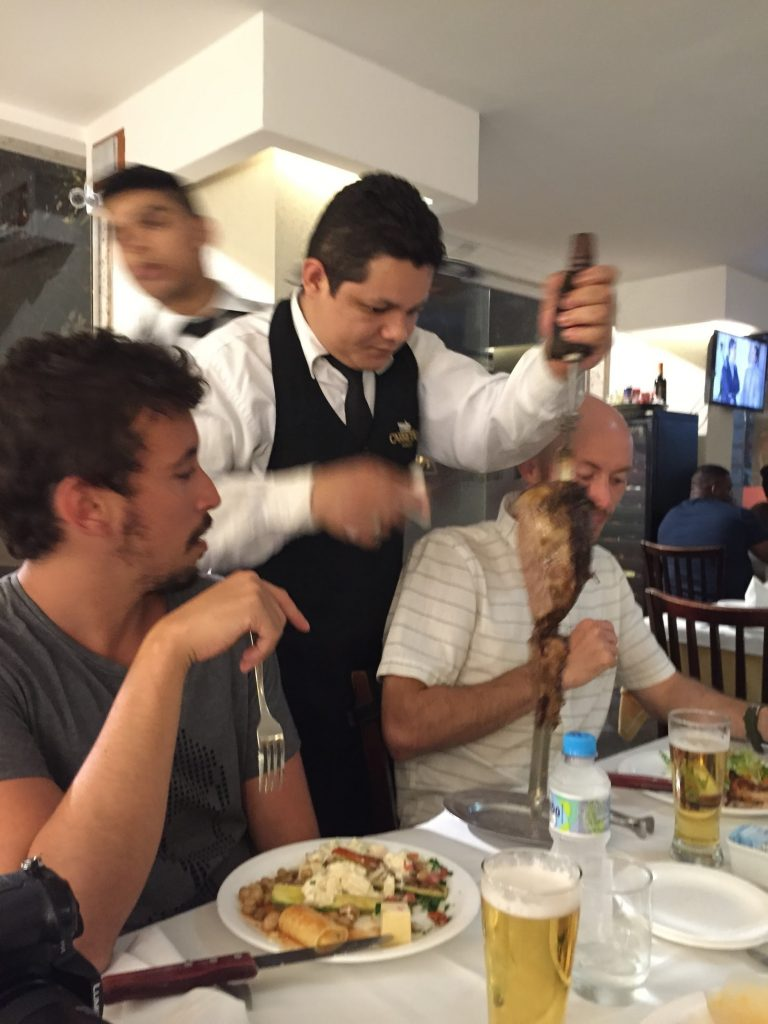 Men eating meat at the churrascaria