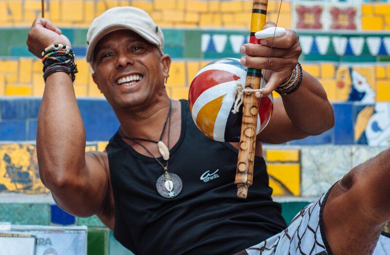A local gentleman plays a berimbau on the Escadaria Selarón