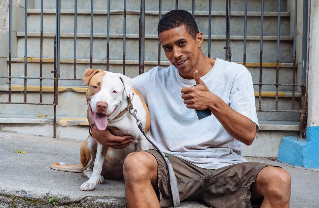 A man out walking his dog in Lapa