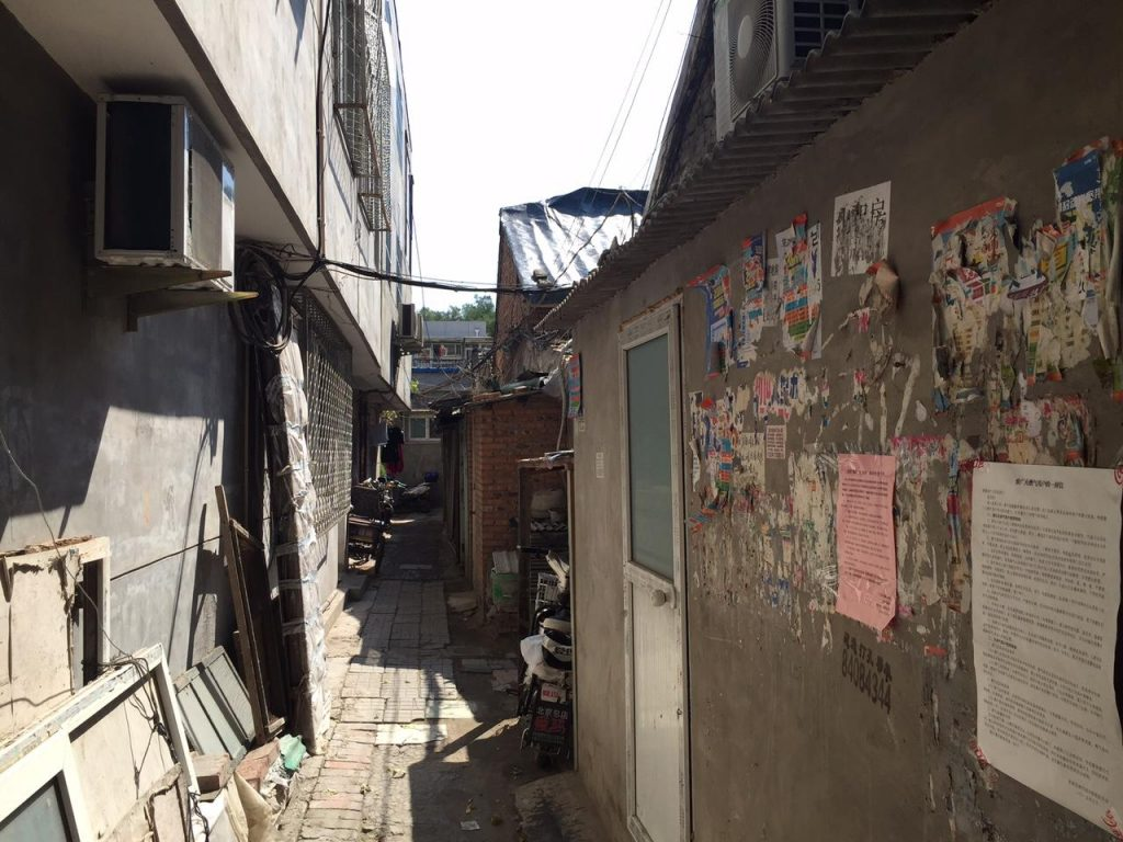 A glimpse down the narrow alley separating the courtyard houses